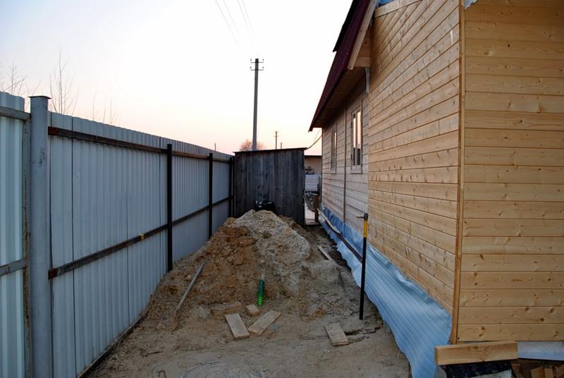 Расстояние между гаражом и соседским забором